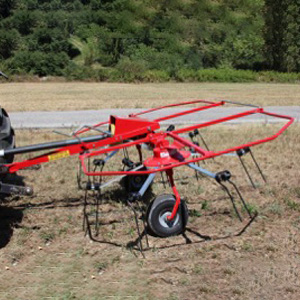 Enorossi G2 Mounted 2 Rotar Tedder on a field
